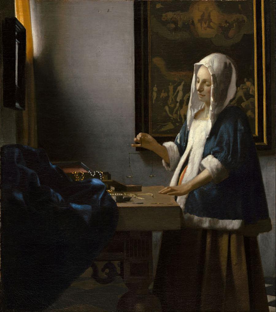 Vermeer kvinde der holder en vægt